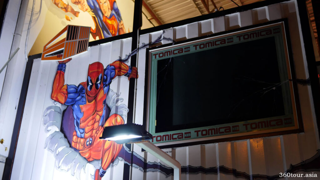 The dead pool mural beside the large screen display at the entrance