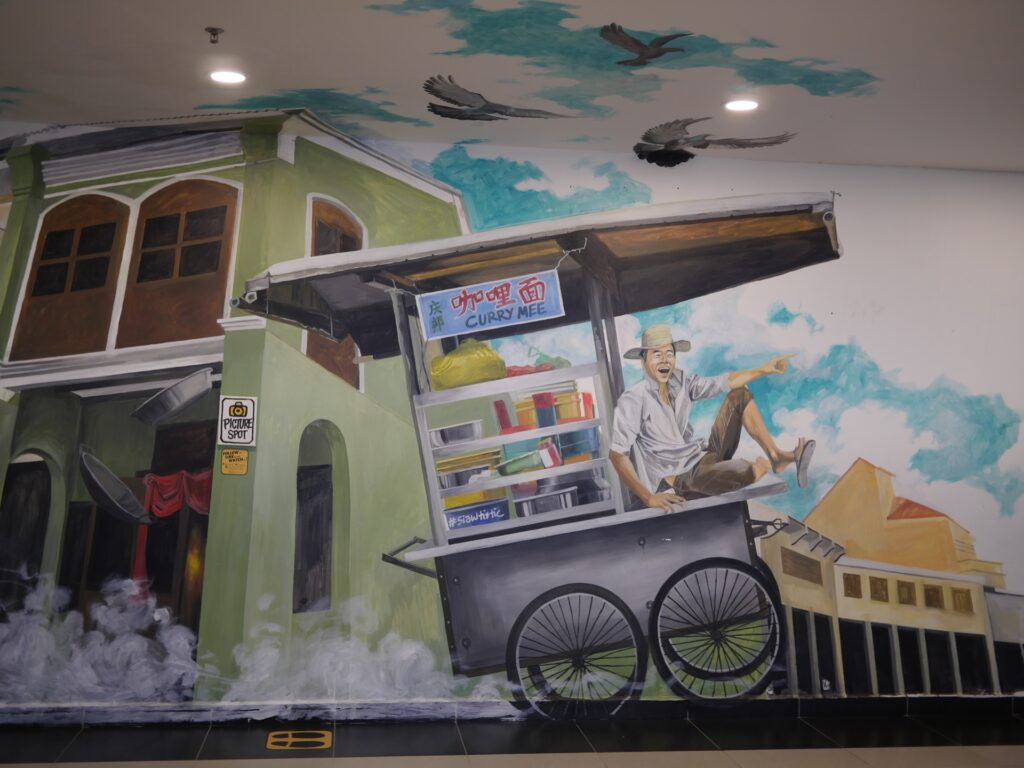 mural depicts a hawker stall been pushed around the street
