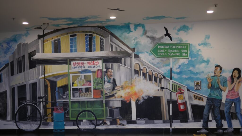 mural depicts a firely hot cooking at a hawker stall