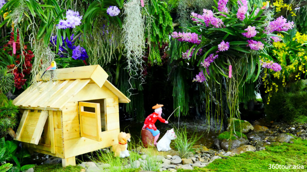 The small wooden hut and the fishing old man beside the water feature.